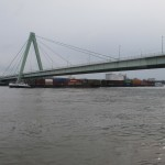 Severin Bridge with barge passing underneath